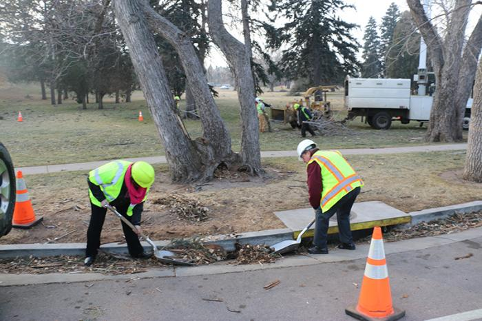 Mayor and another city worker clean street gutters after wind storm